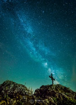 The Milky Way over old cross