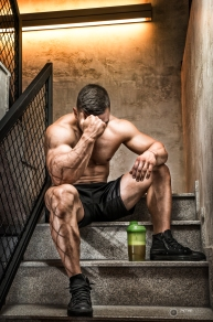 Bodybuilder resting after hard workout