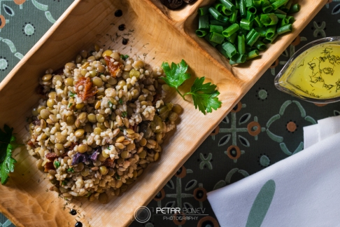 Traditional lentils salad with dried tomatoes, olives and couscous